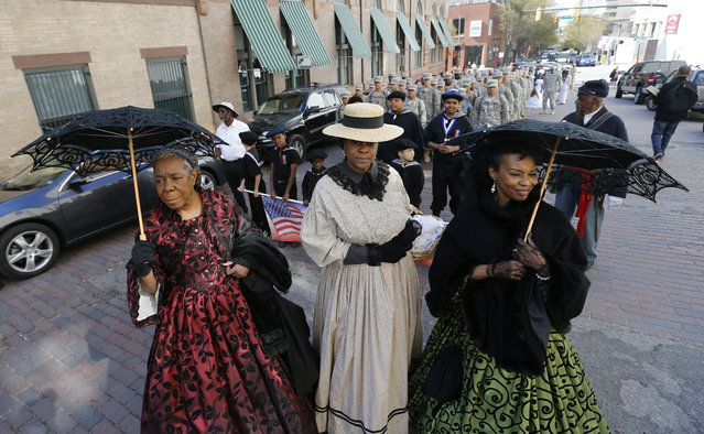 Women of the Civil War Mabel Gantt, left, Denise Benedetto, center, and Malanna Henderson, right, all from Fredericksburg, Va., wait as they prepare march on the State Capitol as they commemorate the 150th anniversary of the fall of Richmond  in Richmond, Va., Saturday, April 4, 2015. 150 years ago the Confederate Army abandoned its capital city of Richmond, a prelude to General Robert E. Lee's surrender just days later in Appomattox. (Photo by Steve Helber/AP Photo)