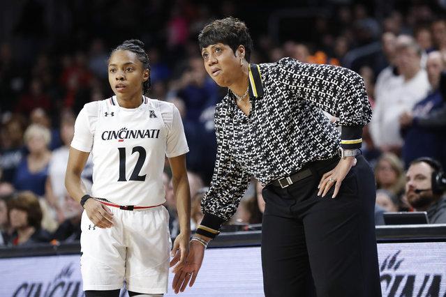 Cincinnati head coach Michelle Clark-Heard, right, speaks with Antoinette Miller (12) in the first half of a women's NCAA college basketball game, Saturday, February 2, 2019, in Cincinnati. (Photo by John Minchillo/AP Photo)