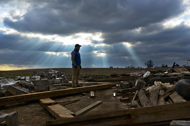 The Weather Channel's on-camera meteorologist Mike Bettes reports from Fairdale, Ill., on Friday, April 10, 2015 after the devastating tornado outbreak on Thursday, April 9, 2015. (Matt Marton/AP Images for The Weather Channel)