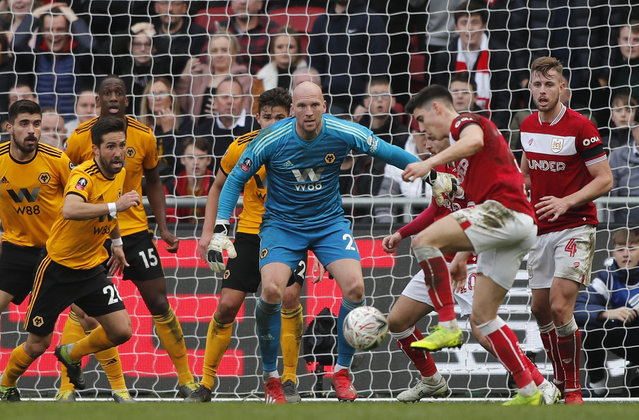 Wolverhampton goalkeeper John Ruddy, center, eyes the ball during the English FA Cup fifth round soccer match between Bristol City and Wolverhampton Wanderers at Ashton Gate stadium in Bristol, England, Sunday, February 17, 2019. (Photo by Frank Augstein/AP Photo)