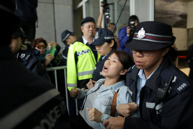 A protester is arrested by police after storming Hong Kong government headquarters over a proposal to extradite fugitives to mainland China, in Hong Kong, China on March 15, 2019. (Photo by Stanley Leung/Reuters)
