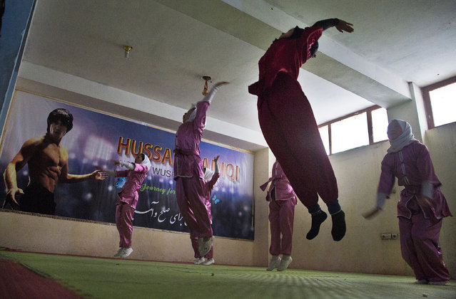 Shaolin martial arts students practice at their club in Kabul, Afghanistan, Tuesday, January 25, 2017. When they aren't training on the snow covered hills that surround Kabul, the students train in the grungy, dark club financed by a young cinema actor. (Photo by Massoud Hossaini/AP Photos)