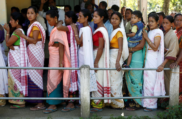 People line up to cast their votes outside a polling station in Majuli, a large river island in the Brahmaputra river, in the northeastern Indian state of Assam, India April 11, 2019. (Photo by Adnan Abidi/Reuters)