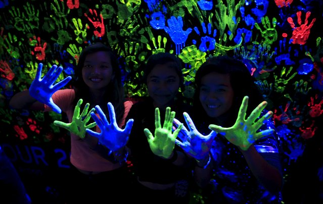 Participants display their hands with neon paints during the Earth Hour in Pasay city, metro Manila, Philippines on March 19, 2016. (Photo by Romeo Ranoco/Reuters)