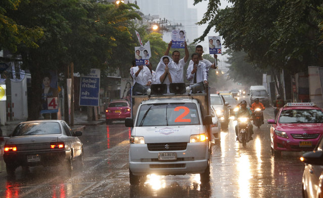 In this  March 17, 2019, photo, the Thai Palang Pracharat Party members parade through a town on a truck in Bangkok, Thailand. Thailand heads to the polls Sunday, March 24, 2019 to vote in the country's first general election since the military toppled an elected government in a coup nearly five years ago. (Photo by Sakchai Lalit/AP Photo)