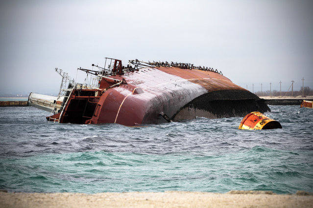 The decommissioned Russian Navy Ochakov cruiser was sunk at the entrance to Donuzlav Bay in Crimea, on March 6, 2014. (Photo by Alexei Pavlishak/ITAR-TASS/ZUMA Press)
