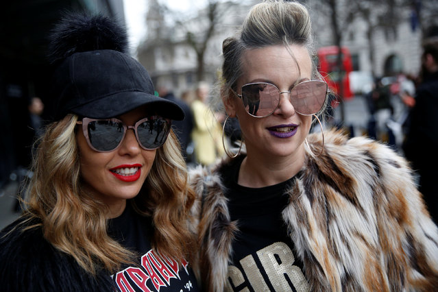 Fashion writers Vered Horen and Shiri Wizner pose for a portrait during London Fashion Week in London, Britain February 21, 2017. (Photo by Neil Hall/Reuters)