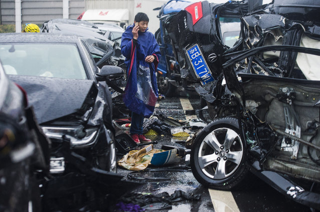 Rescuers work at a rear-end collision site at a expressway on April 2, 2016 in Changzhou, Jiangsu Province of China. The traffic accident happened in Changzhou Saturday after killed two people and another 29 injured. (Photo by VCG/VCG via Getty Images)