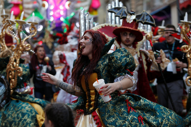A reveller wearing a costume dances as she holds a dring during the carnival street parade in Valletta, Malta, February 25, 2017. (Photo by Darrin Zammit Lupi/Reuters)