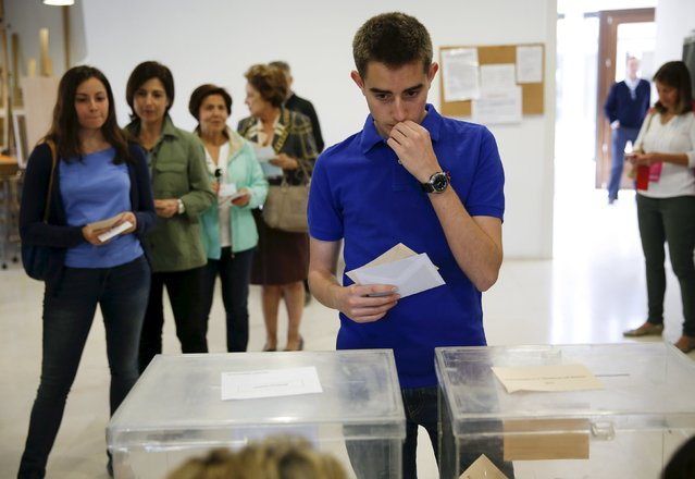 A voter waits to cast his ballot at a polling station during regional and municipal elections in Pozuelo de Alarcon, outside Madrid, Spain, May 24, 2015. Spaniards are expected to sweep aside 40 years of predictable politics when they vote in regional elections on Sunday and usher in an unstable era of coalition and compromise, likely to curtail the authority of Spain's Prime Minister Mariano Rajoy. (Photo by Paul Hanna/Reuters)