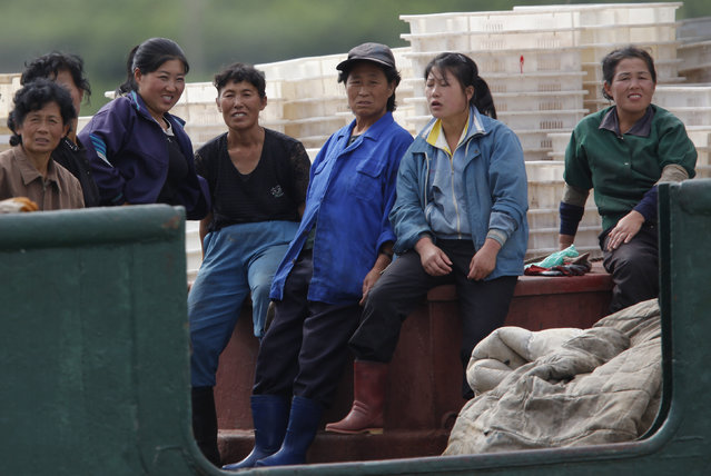 Female workers takes a break on a fishing boat at the port of Rajin, in North Korean Special Economic Zone of Rason City, northeast of Pyongyang September 2, 2011. (Photo by Carlos Barria/Reuters)