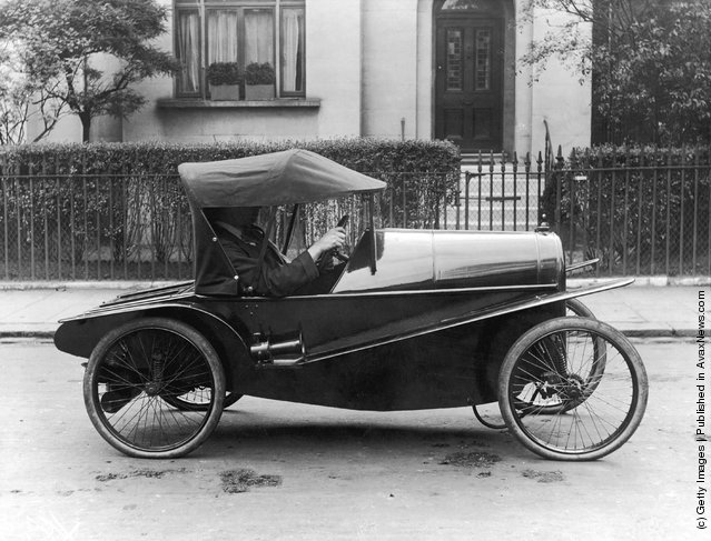 A very early Carden 'Lightcar' being driven along the street, 1916