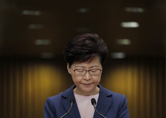 Hong Kong Chief Executive Carrie Lam pauses during a press conference in Hong Kong, Tuesday, July 9, 2019. Lam said Tuesday the effort to amend an extradition bill was dead, but it wasn't clear if the legislation was being withdrawn as protesters have demanded. (Photo by Vincent Yu/AP Photo)