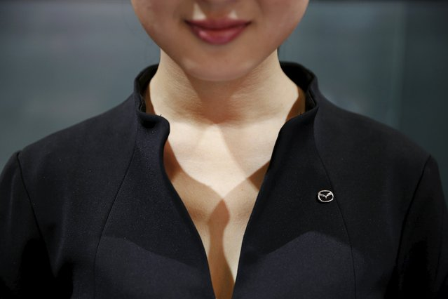 A girl wears a Mazda pin at the company's booth during the Auto China 2016 auto show in Beijing April 25, 2016. (Photo by Damir Sagolj/Reuters)