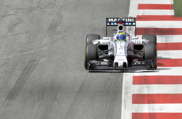 Third placed Williams driver Felipe Massa of Brazil steers his car during the Austrian Formula One Grand Prix race at the Red Bull Ring  in Spielberg, southern Austria, Sunday, June 21, 2015. (AP Photo/Kerstin Joensson)