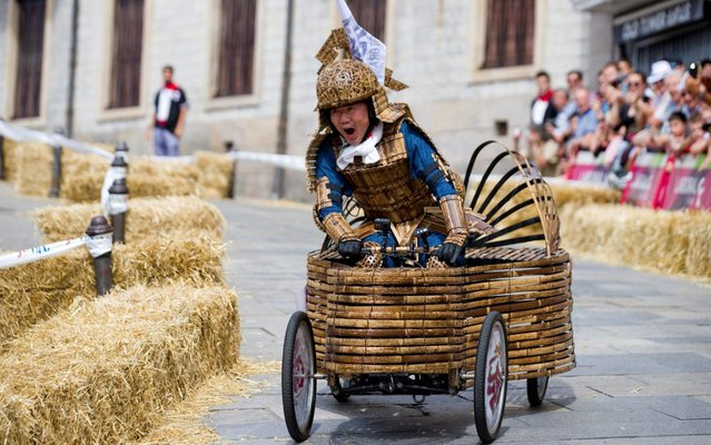"Japanese driver Yoshihiro Yamagishi participates in the fourth edition of the race of ""goitiberas"", homemade vehicles, during the traditional festivities in honor of the Virgen Blanca (White Virgin), the patron saint of the city, in Vitoria, Alava, Basque Country, northern Spain, 06 August 2019. A papamobile, a firefighter's truck and a bamboo gadget piloted by Yamagishi were among the homemade vehicles that took part in the race. The Fiestas de la Virgen Blanca runs from 04 to 09 August. (Photo by David Aguilar/EPA/EFE/Rex Features/Shutterstock)"