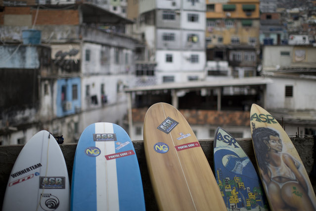 Boards stand lined up at the Rocinha Surf Association, ASR, headquarters at Rocinha slum in Rio de Janeiro, Brazil, Thursday, July 2, 2015. ASR has given free lessons to over 2,000 children from Rio's shantytowns in the hopes of keeping the boys, who are mostly in their early teens and a few girls occupied by the sport and off the streets. (Photo by Felipe Dana/AP Photo)