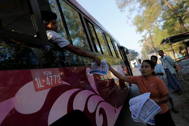 A member of the National League for Democracy party distributes leaflets to show a new bus route in Yangon, Myanmar January 16, 2017. (Photo by Soe Zeya Tun/Reuters)