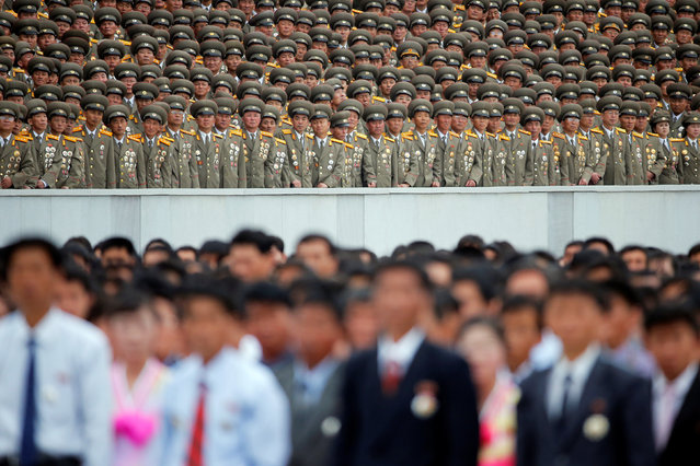 Military officials stand above other participants during a mass rally and parade in the capital's main ceremonial square, a day after the ruling party wrapped up its first congress in 36 years by elevating him to party chairman, in Pyongyang, North Korea, May 10, 2016. (Photo by Damir Sagolj/Reuters)