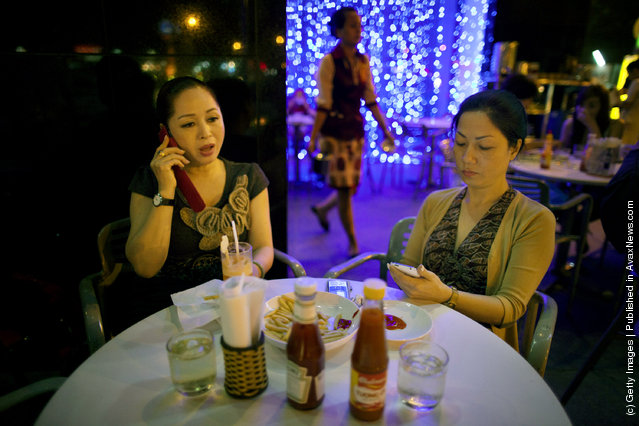 Vietnamese women dine at an expensive cafe
