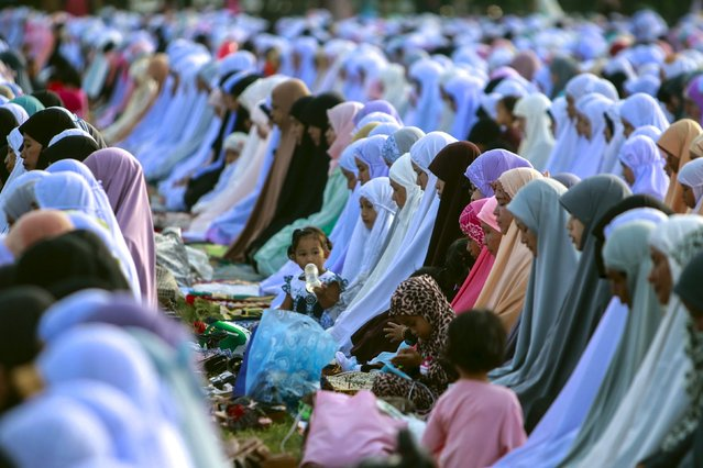 Thai Muslims attend a mass prayer during the Eid al-Fitr celebrations at a mosque in Yala province, Thailand, July 17, 2015. (Photo by Surapan Boonthanom/Reuters)