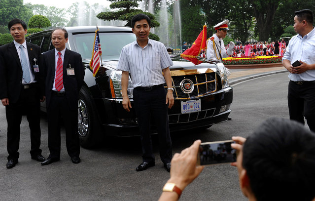 Vietnamese security officers pose next to U.S. President Brack Obama's limousine at the Presidential Palace when Obama holds official talks with his Vietnamese counterpart Tran Dai Quang in Hanoi, Vietnam on May 23, 2016. (Photo by Hoang Dinh Nam/Reuters)