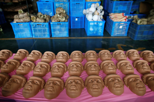 Masks of U.S. Republican presidential candidate Donald Trump are seen at Jinhua Partytime Latex Art and Crafts Factory in Jinhua, Zhejiang Province, China, May 25, 2016. (Photo by Aly Song/Reuters)