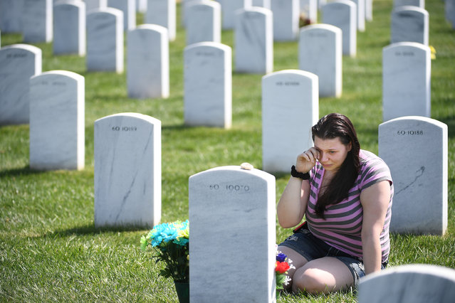 Krista Barham of Hyattsville, MD cries as she visits the grave of her friend, Eugene C. Mills III at Arlington National Cemetery on Easter Sunday April 16, 2017 in Arlington, VA. Mills died while serving with the United States Marine Corps. in Afghanistan in 2012. (Photo by Matt McClain/The Washington Post)