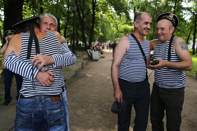 Ex-mariners celebrate the Day of Russian Navy on July 26, 2015 in St Petersburg, Russia. Introduced in 1939 by the Soviet government as a national holiday, Navy Day in Russia is celebrated annually on the last Sunday of July. (Photo by Alexander Aksakov/Getty Images)