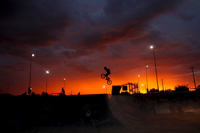 A BMX rider performs a trick at a skate park in Ciudad Juarez, Mexico, July 21, 2015. (Photo by Jose Luis Gonzalez/Reuters)