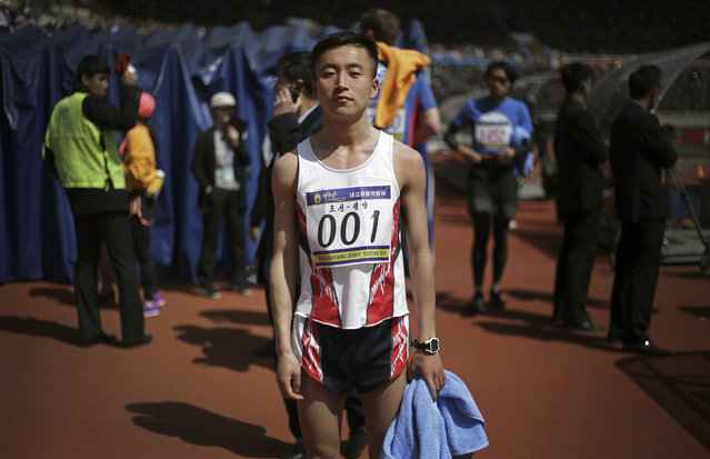 """In this April 9, 2017, photo, Pak Chol, 27, a professional long distance runner, poses for a portrait after winning the Pyongyang marathon in Pyongyang, North Korea. Pak has won three marathons in his life. His motto: """"I want to please leader Kim Jong Un through my sporting successes"""". (Photo by Wong Maye-E/AP Photo)"""
