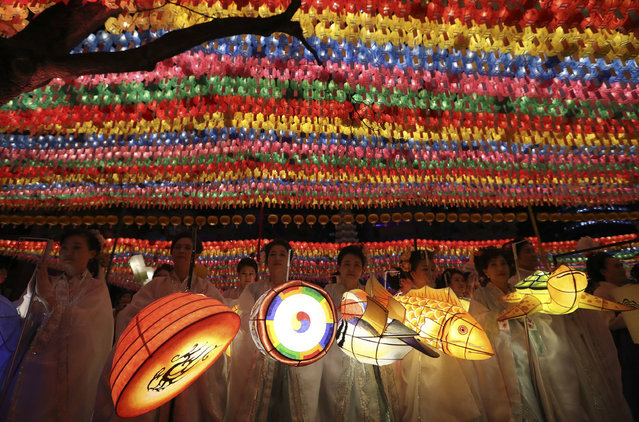Buddhists hold lanterns after a parade during the Lotus Lantern Festival celebrating the upcoming birthday of Buddha on May 3, at the Jogye Temple in Seoul, South Korea, Saturday, April 29, 2017. (Photo by Lee Jin-man/AP Photo)
