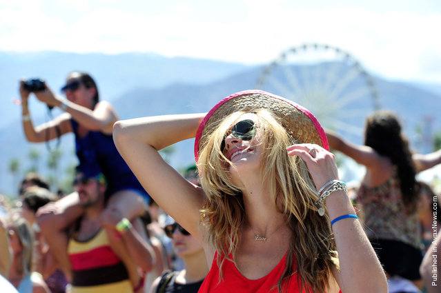 Music fans dance during Day 3 of Coachella 2012, on April 15, 2012