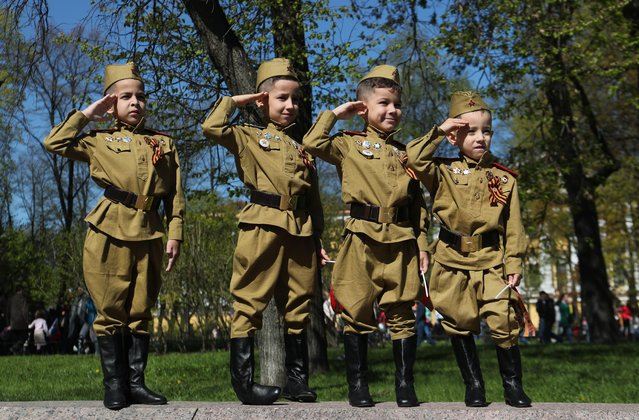 Children in uniforms salute during the Victory Day celebrations, which marks the anniversary of the victory over Nazi Germany in World War Two, in St. Petersburg, Russia on May 9, 2019. (Photo by Anton Vaganov/Reuters)