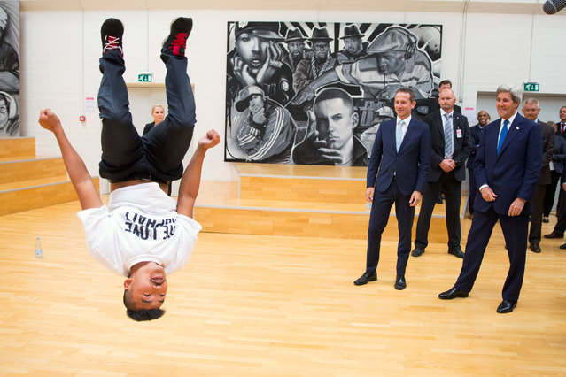 U.S. Secretary of State John Kerry (R) and Danish Foreign Minister Kristian Jensen look on as a breakdancer performs during a tour of GAME, an organization that promotes youth sports, in Copenhagen, Denmark June 17, 2016. (Photo by Evan Vucci/Reuters)