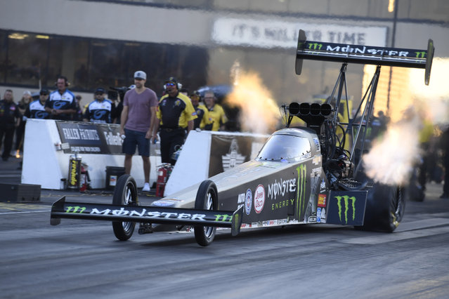 In this photo provided by the NHRA, Brittany Force drives in Top Fuel qualifying Saturday, July 8, 2017, at the NHRA Route 66 Nationals drag races in Joliet, Ill. (Photo by Jerry Foss/NHRA via AP Photo)