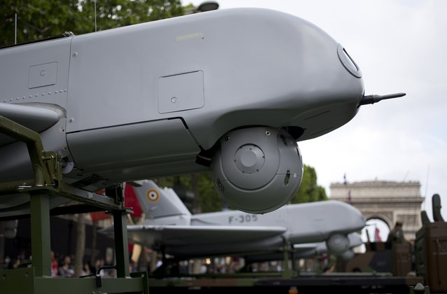 SDTI F-305 type drones are set on trucks prior to the start of the annual Bastille Day military parade on the Champs-Elysees avenue in Paris, on July 14, 2014. (Photo by Kenzo Tribouillard/AFP Photo)