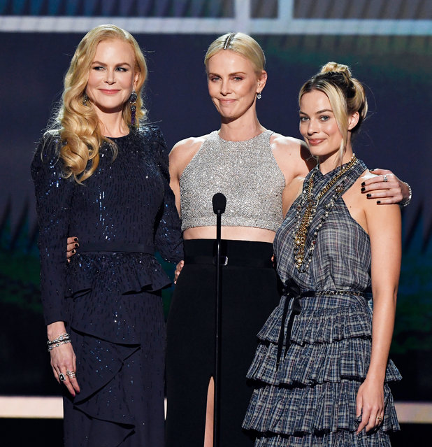 (L-R) Nicole Kidman, Charlize Theron, and Margot Robbie speak onstage during the 26th Annual Screen Actors Guild Awards at The Shrine Auditorium on January 19, 2020 in Los Angeles, California. (Photo by Kevork Djansezian/Getty Images for Turner)