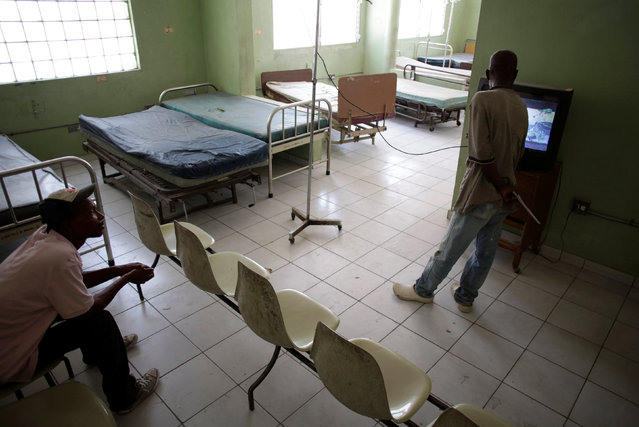 Workers watch television in an empty room at the Hospital of the State University of Haiti, which is one of the centers affected by a three-month-long strike by health workers demanding a pay rise and resources, in Port-au-Prince, Haiti, June 20, 2016. (Photo by Andres Martinez Casares/Reuters)