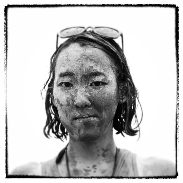A festival goer poses during the annual Boryeong Mud Festival at Daecheon Beach on July 18, 2014 in Boryeong, South Korea. The mud, which is believed to have beneficial effects on the skin due to its mineral content, is sourced from mud flats near Boryeong and transported to the beach by truck. (Photo by Chung Sung-Jun/Getty Images)