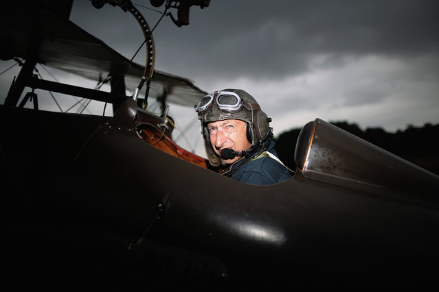 """Shuttleworth Collection Pilot Rodger """"Dodge"""" Bailey prepares for a demonstration flight in a SE5a at """"The Shuttlesworth Collection"""" at Old Warden on July 21, 2014 in Biggleswade, England. (Photo by Dan Kitwood/Getty Images)"""