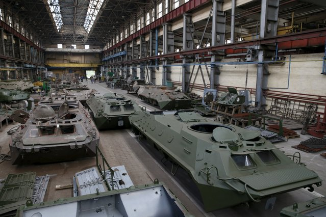 Armored vehicles are repaired at the Kiev armored plant, Ukraine, August 14, 2015. (Photo by Valentyn Ogirenko/Reuters)