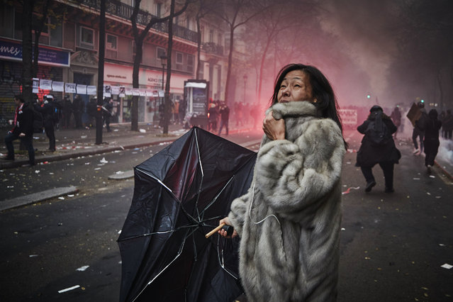 A protestor screams amidst clouds of tear gas as protestors and French Riot Police clash during a rally near Place de Republique in support of the national strike in France, one of the largest nationwide strikes in years, on December 05, 2019 in Paris, France. President Emmanuel Macron is facing his biggest test since the Gilet Jaune or Yellow Vest movement as railway, transportation workers, teachers, students, hospital employees, police officers, garbage collectors, truck drivers and airline workers join the strike called in protest to changes to Frances pension system. (Photo by Kiran Ridley/Getty Images)