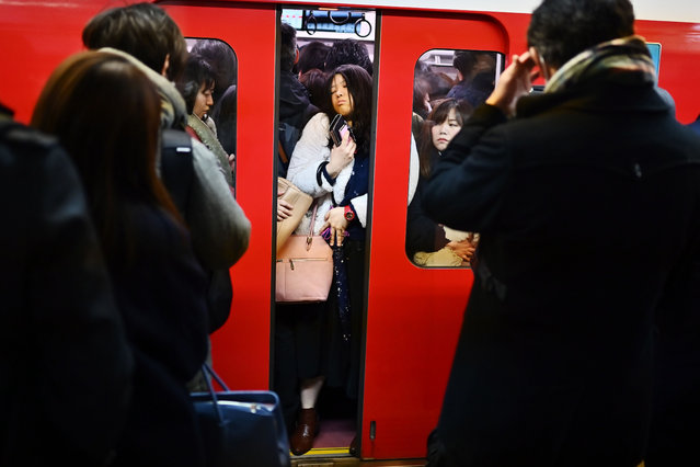 Morning rush hour time in Tokyo metro train on January 28, 2020. (Photo by Charly Triballeau/AFP Photo)