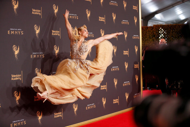 """Jessie Graff from """"American Ninja Warrior"""" poses for photographers at the 2017 Creative Arts Emmy Awards in Los Angeles, California September 9, 2017. (Photo by Danny Moloshok/Reuters)"""