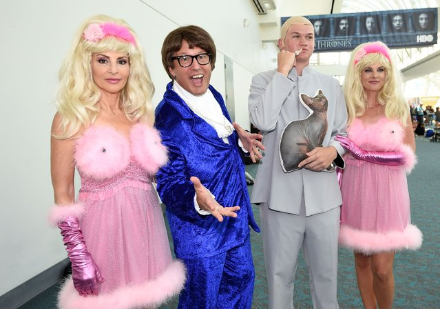 Comic-Con fans dressed as characters from the Austin Power's movies pose for a photo on day two of Comic-Con International held at the San Diego Convention Center Friday, July 22, 2016, in San Diego. (Photo by Denis Poroy/Invision/AP Photo)