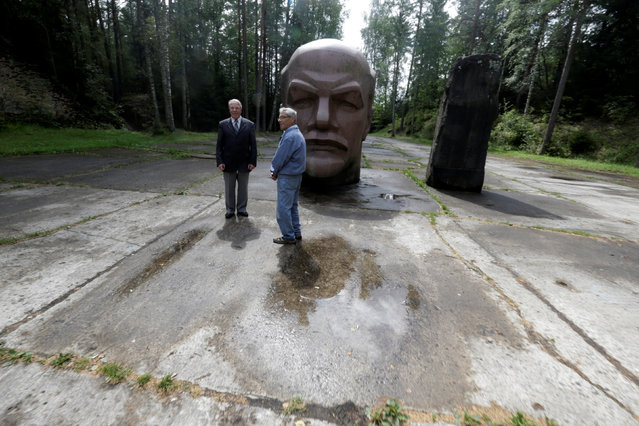 Former Soviet Army officers Leonid Konovalov (L) and Vladimir Procenko stand near the abandoned Soviet R12 nuclear missile launch site in Zeltini, Latvia, July 22, 2016. (Photo by Ints Kalnins/Reuters)