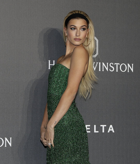 Model Hailey Baldwin poses as she arrives for the amfAR charity dinner during the fashion week in Milan, Italy, Thursday, September 21, 2017. (Photo by Antonio Calanni/AP Photo)