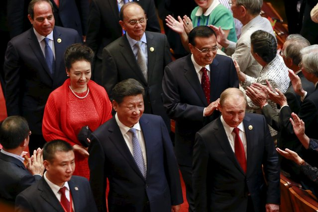 Russia's President Vladimir Putin (front, R), China's President Xi Jinping (front, L), his wife Peng Liyuan (2nd row, L), and China's Premier Li Keqiang (2nd row), arrive for a gala show to mark the 70th anniversary of the end of World War Two, in Beijing, China, September 3, 2015. (Photo by Kim Kyung-Hoon/Reuters)