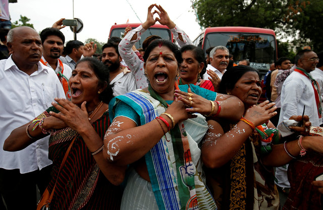 Supporters of India's main opposition Congress party shout anti-government slogans during a protest against rising petrol prices, in Ahmedabad, India, September 22, 2017. (Photo by Amit Dave/Reuters)